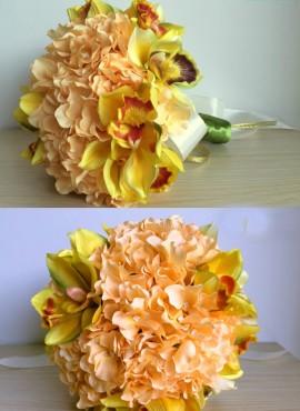 bouquet sposa con fiori color pesca arancio e orchidee