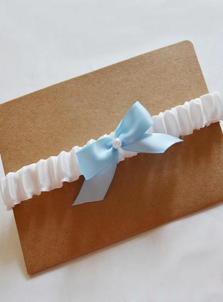 Giarrettiera sposa avorio con fiocco azzurro e perlina online