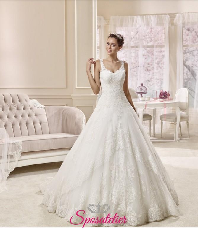 6fb3ca3a6c76 italia- vestito da sposa ampio ricamato in pizzo con strascico lungo