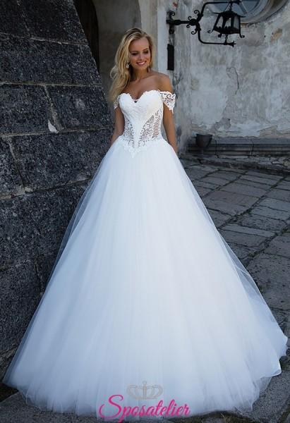 abito da sposa particolare con scollo bardot e traspaenze
