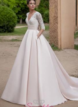 abiti da sposa principesco con gonna in raso colorata e corpetto avorio