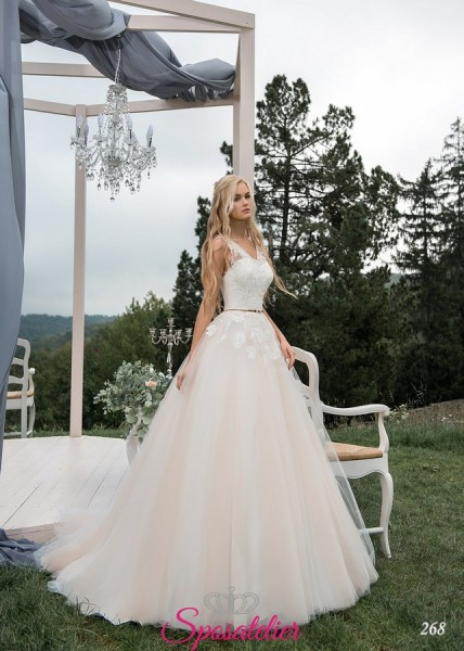 abiti da sposa avorio corpetto di pizzo bianco tendenze nuove collezioni