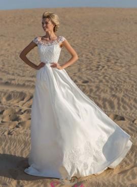 abito da sposa matrimonio in spiaggia tendenze collezione 2019