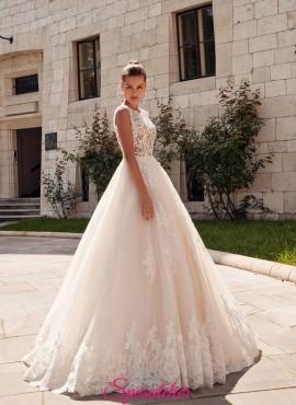 abito da sposa vendita online con ricami di pizzo e gonna colorata collezione 2019