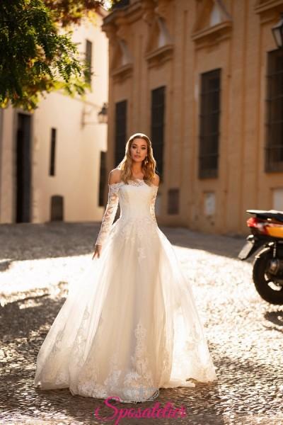 abiti da sposa 2021 tendenze con scollo a barca e gonna da principessa