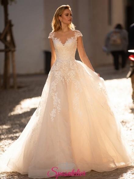 abiti da sposa online nuova collezione con gonna da principessa e ricami di pizzo